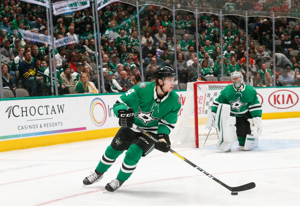 Dallas Stars defenseman Miro Heiskanen (4) moves the puck during the second period of an NHL matchup between the Dallas Stars and the Chicago Blackhawks on Sunday, Feb. 23, 2020 at American Airlines Center in Dallas.