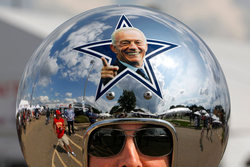 Dallas Cowboys fan Gregg Wilson, of Dallas, arrives for the Pro Football Hall of Fame inductions, including that of Cowboys owner Jerry Jones, whose photo is on the helmet, at the Pro Football Hall of Fame on Saturday, Aug. 5, 2017, in Canton, Ohio. (AP Photo/Gene J. Puskar)