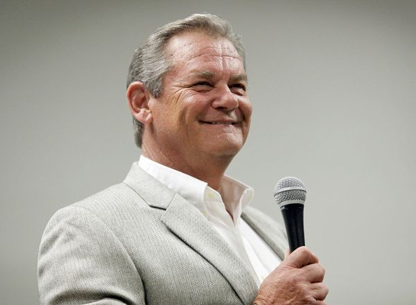 Steve Busby, a broadcaster for the Texas Rangers and former National League pitcher, gives the commencement address for the Texans Can Academy winter graduation.