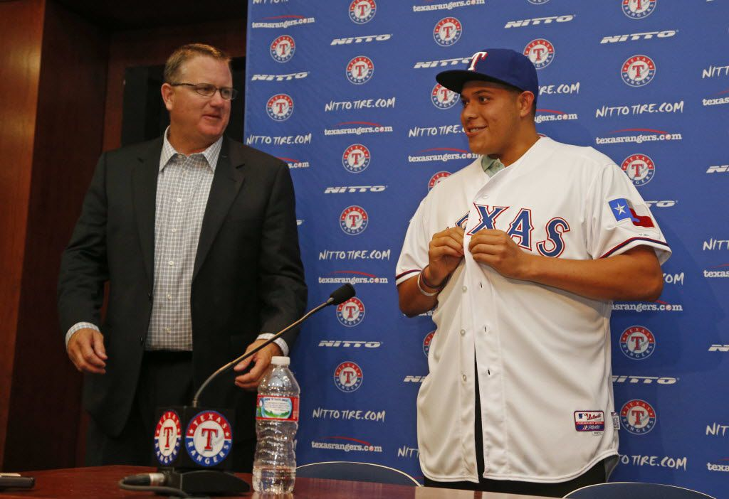 Kip Fagg, left, of the Texas Rangers introduces first round draft pick Luis Ortiz, at Globe Life Park in Arlington, Texas, on June 11, 2014. (Michael Ainsworth/The Dallas Morning News)