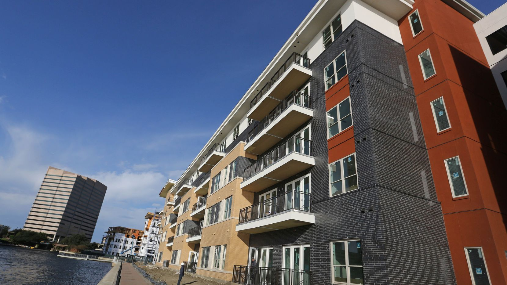 The first lakeside apartments are open in the Water Street development in Las Colinas.