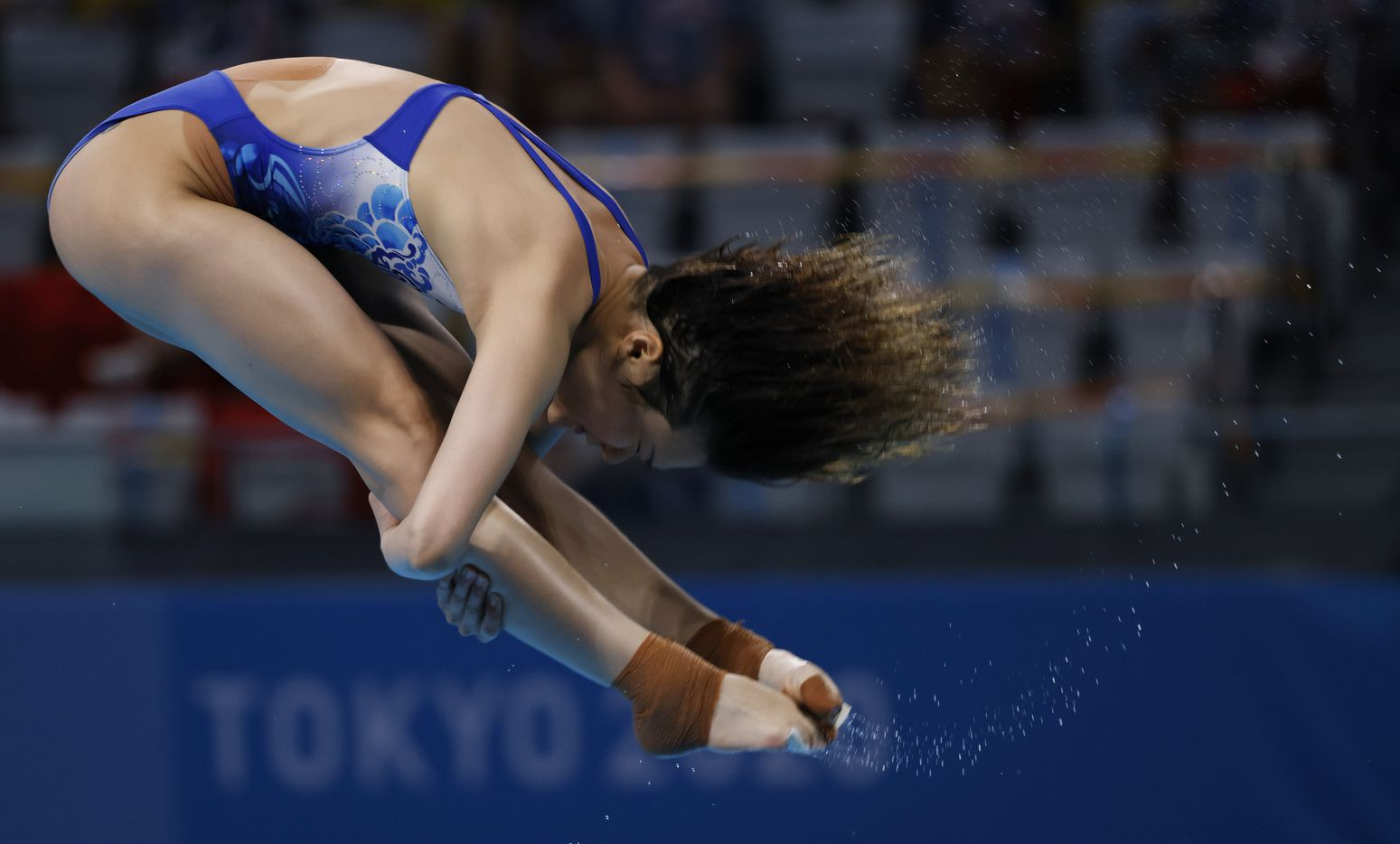China's Shi Tingmao competes in the women's 3 meter springboard preliminary competition during the postponed 2020 Tokyo Olympics at Tokyo Aquatics Centre, on Friday, July 30, 2021, in Tokyo, Japan. (Vernon Bryant/The Dallas Morning News)