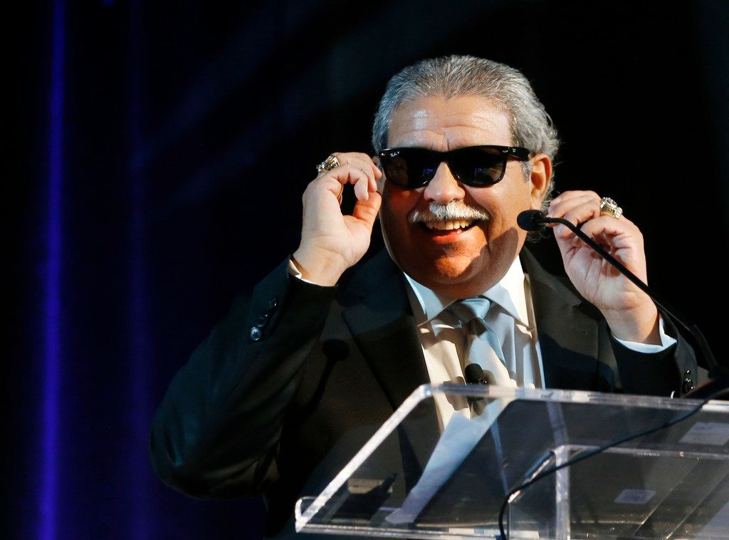 Dallas schools Superintendent Dr. Michael Hinojosa jokes with the audiences as he puts a pair of shades on while speaking at the Dallas ISD State of the District in Dallas on Friday.