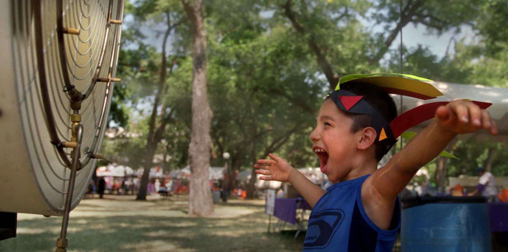 Edward Avila of Dallas cooled off in front of a fan at the Pepsi KidAround at Reverchon Park benefiting the Family Place in 2000.