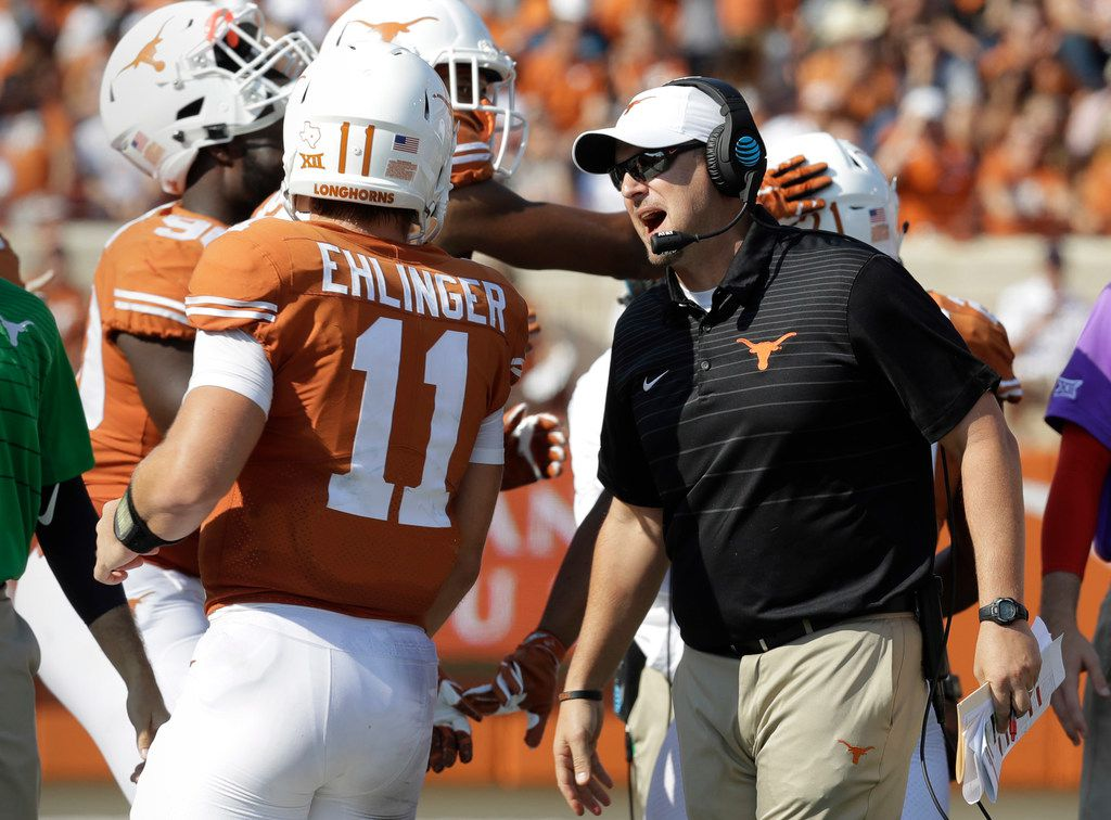 FILE - In this Saturday, Sept. 9, 2017, file photo, Texas head coach Tom Herman, right, talks to quarterback Sam Ehlinger (11) during the second half of an NCAA college football game against San Jose State in Austin, Texas. Fourth ranked Southern California should be wary of Texas' visit to the Coliseum on Saturday night for a marquee early-season showdown.  (AP Photo/Eric Gay, File)