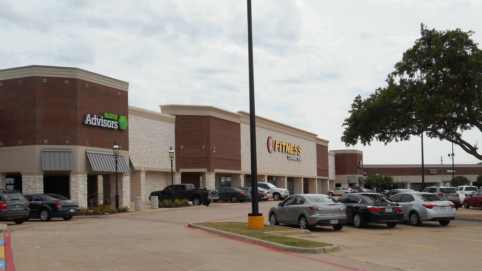 The Mills Pointe shopping center was purchased by Henry S. Miller Co.