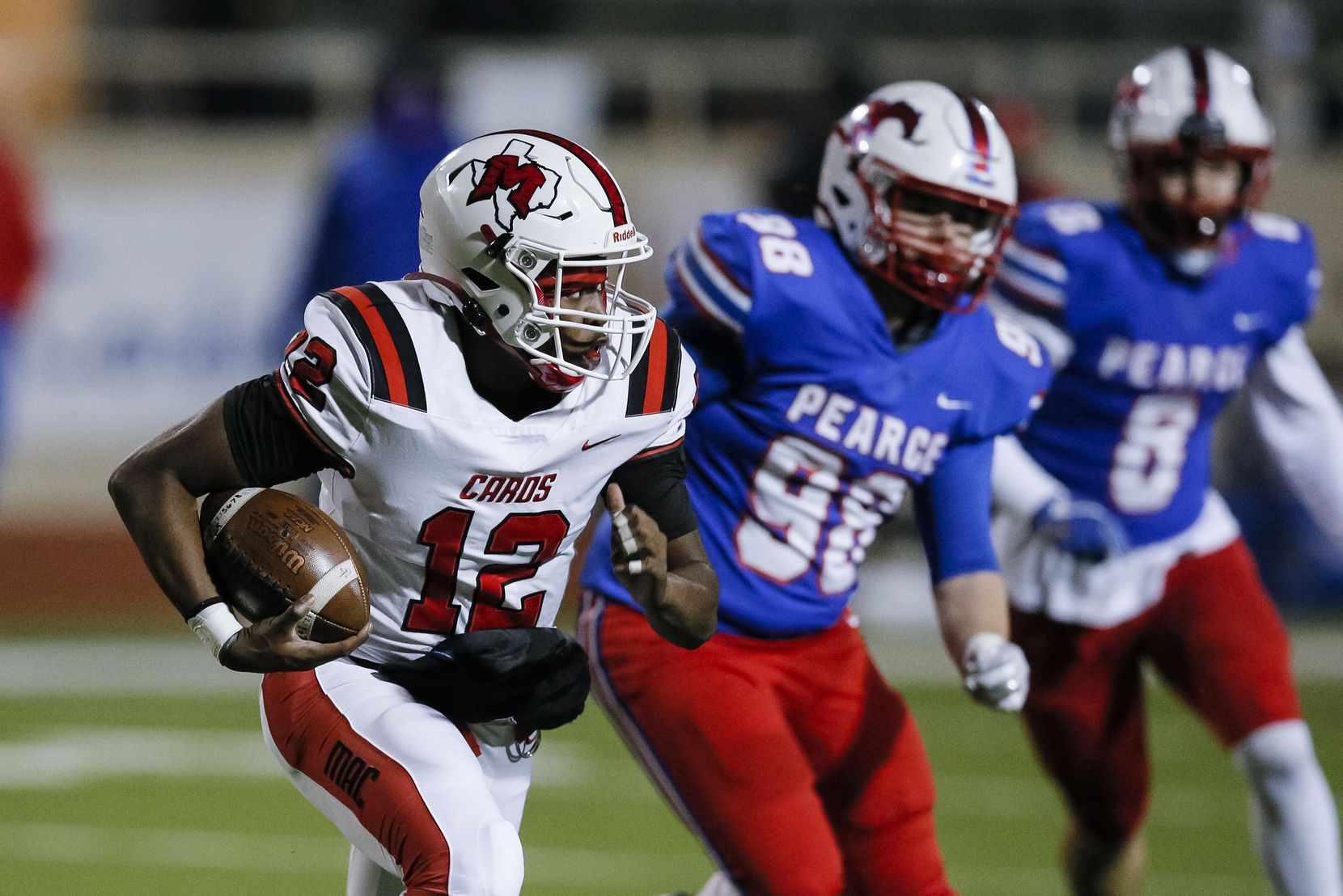 Irving MacArthur sophomore quarterback Kyale Flye (12) looks for room against the JJ Pearce defense during the first half of a high school playoff football game at Eagle-Mustang Stadium in Richardson, Thursday, December 3, 2020. (Brandon Wade/Special Contributor)