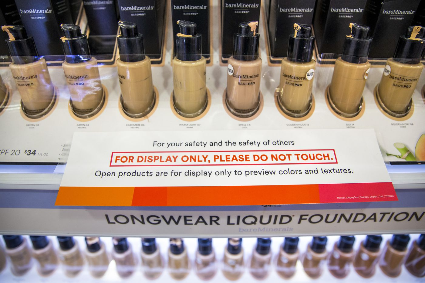A row of sample foundation products is covered in tape to prevent customers from using them at the Ulta Beauty store at The Shops at Park Lane in Dallas on Tuesday. Testers are display-only now to help prevent the spread of the coronavirus.