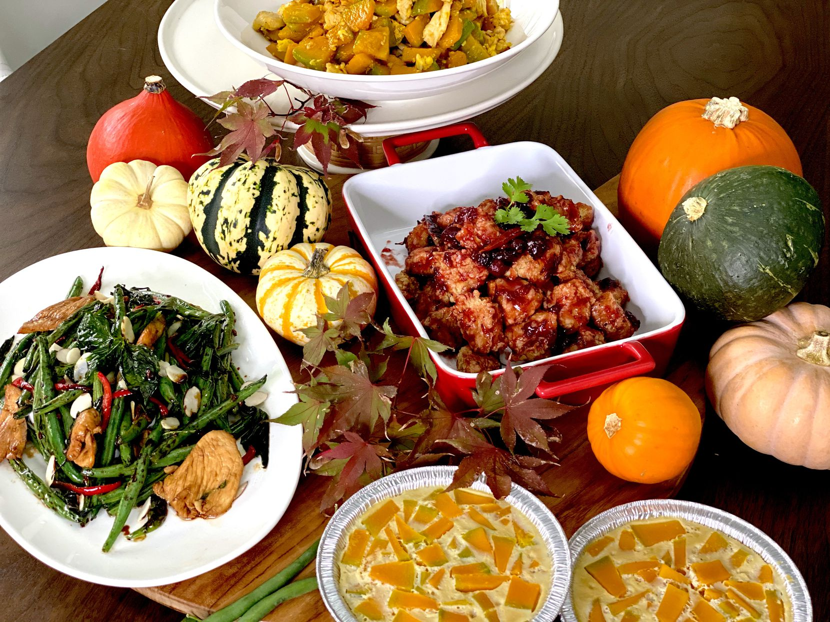 Asian Mint's 2020 Thanksgiving menu includes, clockwise, from top,  golden squash stir fry, cranberry crispy chicken, Thai pumpkin custard and green bean chicken basil with almonds.