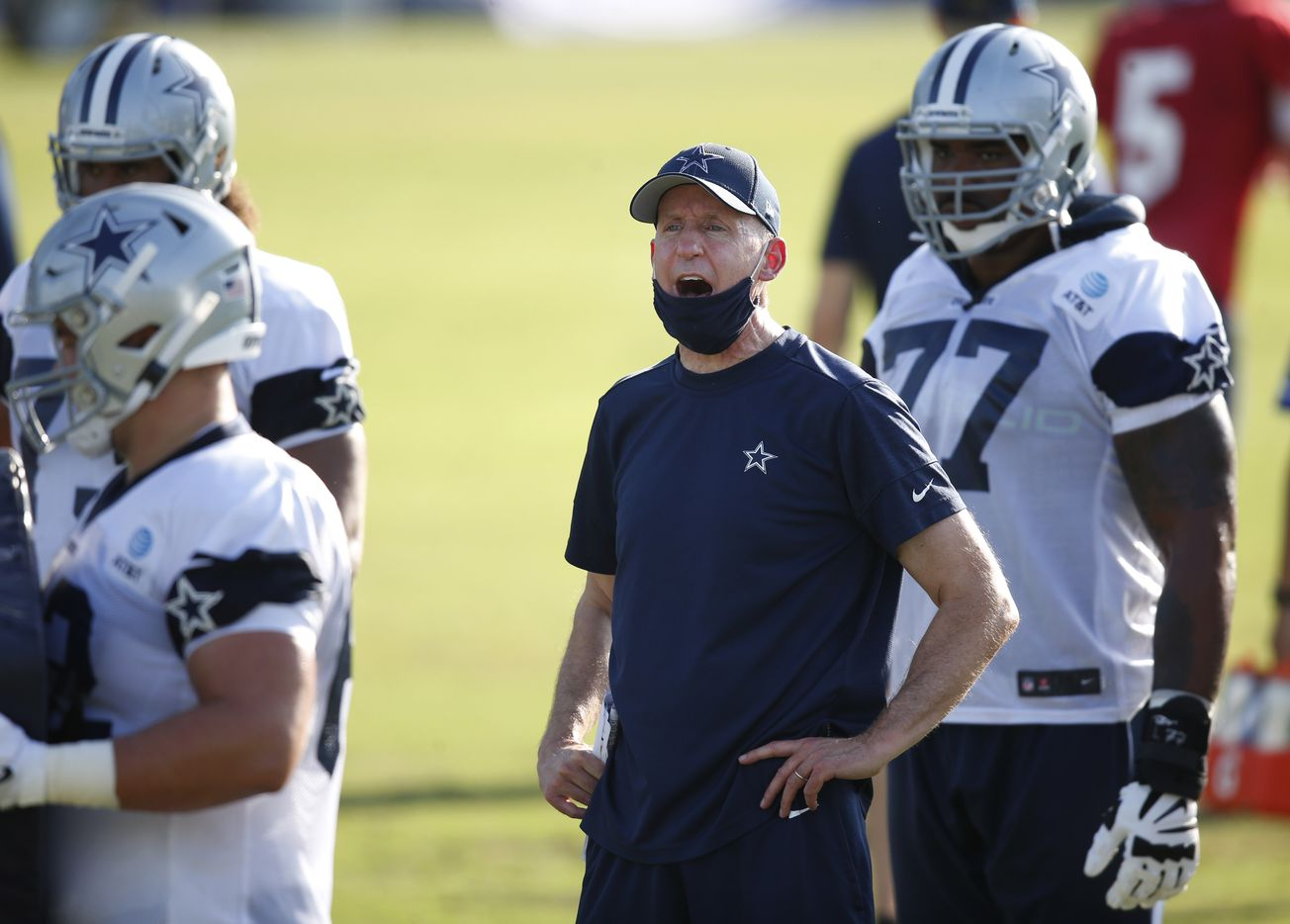 Dallas Cowboys offensive line coach Joe Philbin talks to a player during the first day of training camp at Dallas Cowboys headquarters at The Star in Frisco, Texas on Friday, August 14, 2020. (Vernon Bryant/The Dallas Morning News)