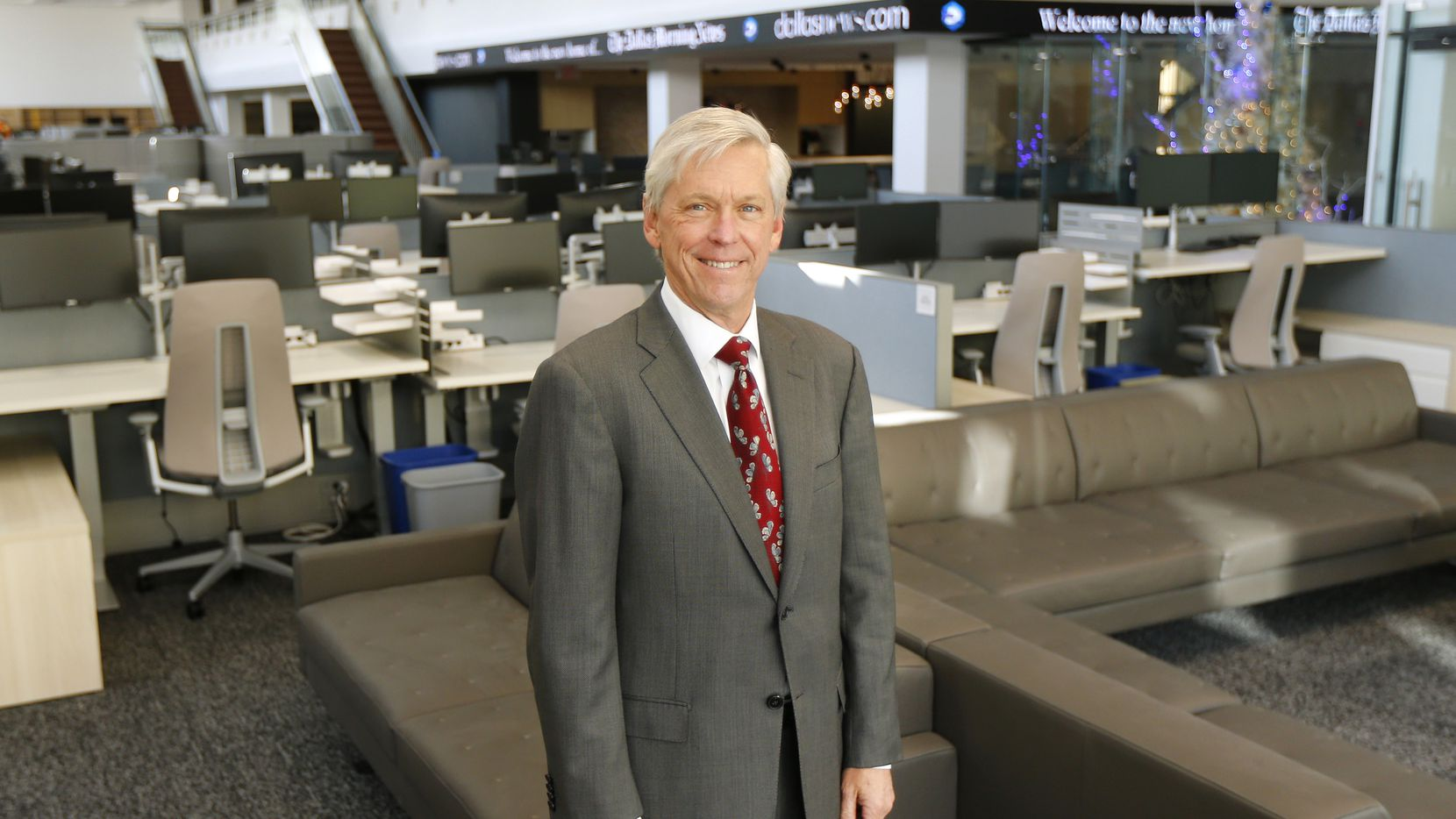 Jim Moroney, standing in The Dallas Morning News' new newsroom at the former Dallas Public Library on Commerce Street, stepped down in March as the newspaper's seventh publisher. On Thursday, he will relinquish the titles of chairman, president and chief executive of Dallas-based A. H. Belo Corporation, the news organization's parent.
