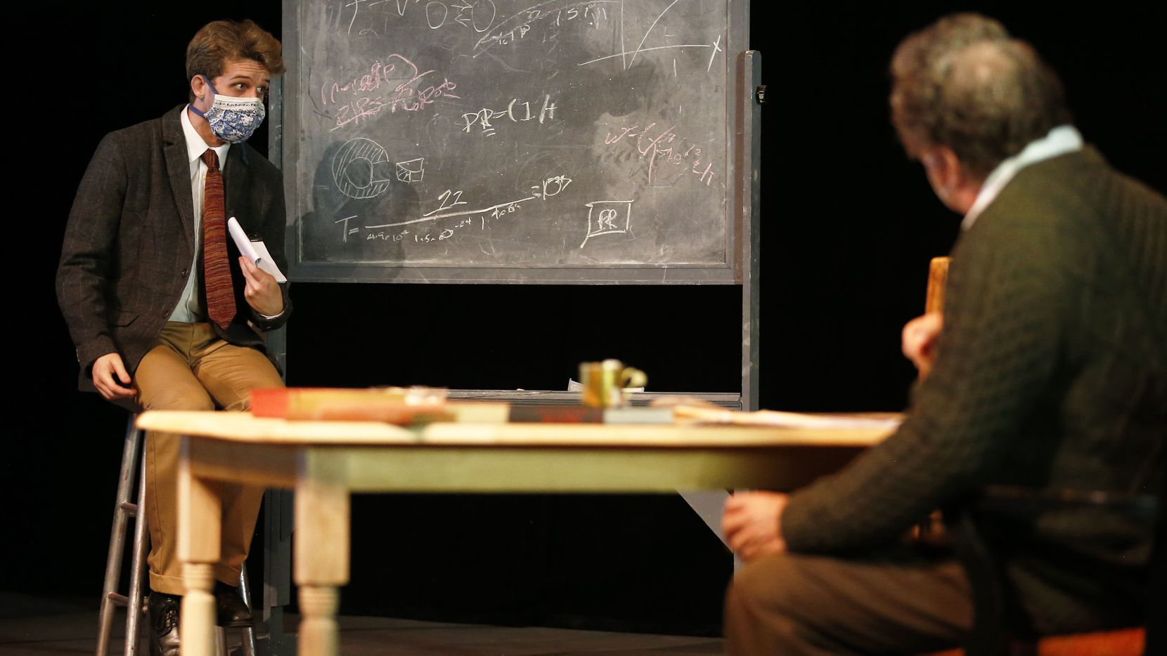 """Robert Oppenheimer played by Evan Michael Woods (left) talks to Albert Einstein played by T.A. Taylor (right) during a rehearsal for 'The Impact of the Gadget on Civilization' on the main stage at Addison Theatre Centre on Sept 5, 2020. The play is a """"what if"""" story: What if Einstein had gone to Los Alamos to talk Oppenheimer out of creating the atomic bomb? The production will stream online Sept. 17-26, presented by Imprint Theatreworks."""