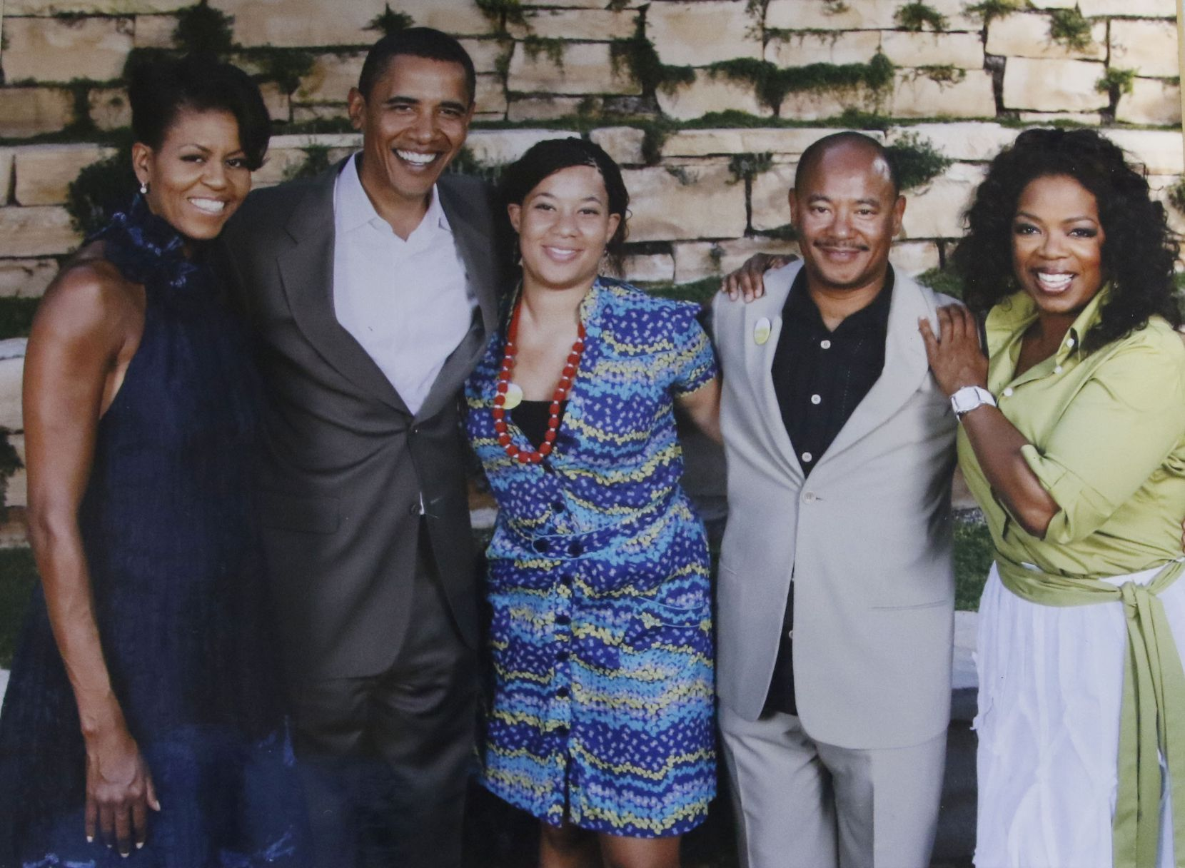 Kneeland Youngblood and his daughter Devon (center) are shown with former President Barack Obama, Michelle Obama and Oprah Winfrey. This picture was shot in Youngblood's office in Dallas in 2015.