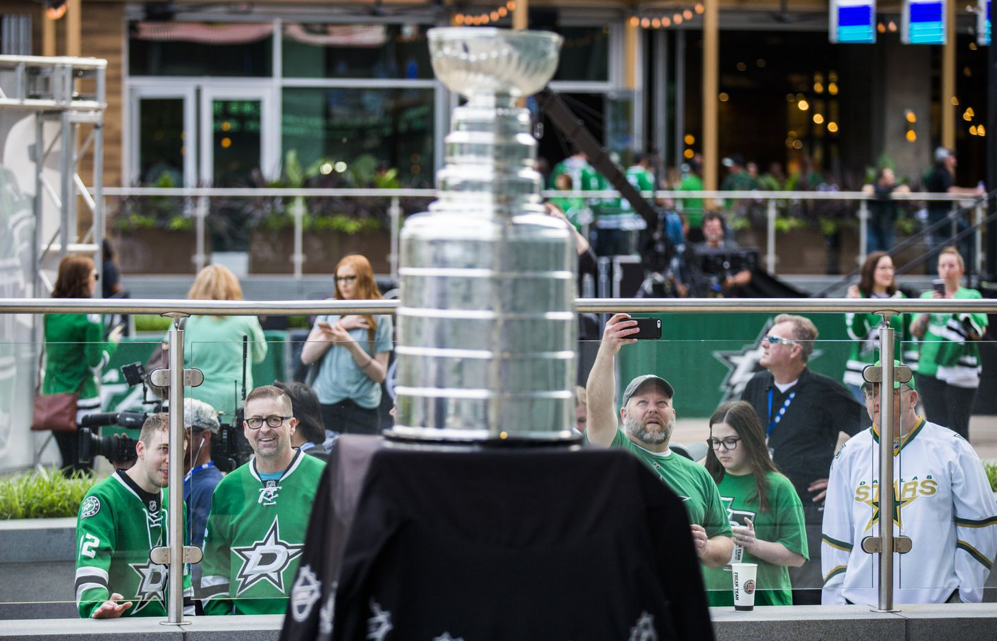 Fans take photos of the Stanley Cup outside American Airlines Center before Game 6 of the first round of the playoffs between Dallas and Nashville.