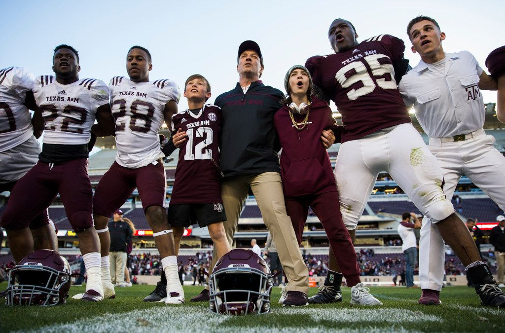 Texas A&M Aggies head coach Jimbo Fisher, center, sings the school song with his team after a Texas A&M University Maroon and White scrimmage football game on Saturday, April 14, 2018 at Kyle Field in College Station, Texas. (Ashley Landis/The Dallas Morning News)