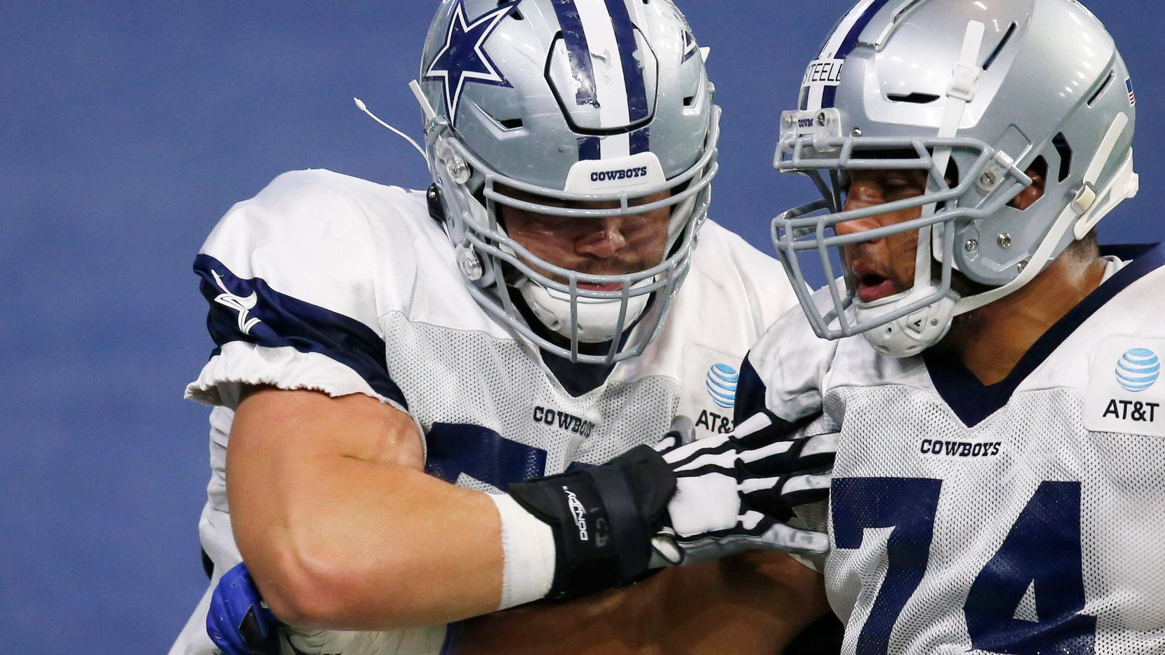 Dallas Cowboys guard Connor Williams (52) blocks Dallas Cowboys offensive tackle Terence Steele (74) in a drill during training camp at the Dallas Cowboys headquarters at The Star in Frisco, Texas on Monday, August 24, 2020. (Vernon Bryant/The Dallas Morning News)