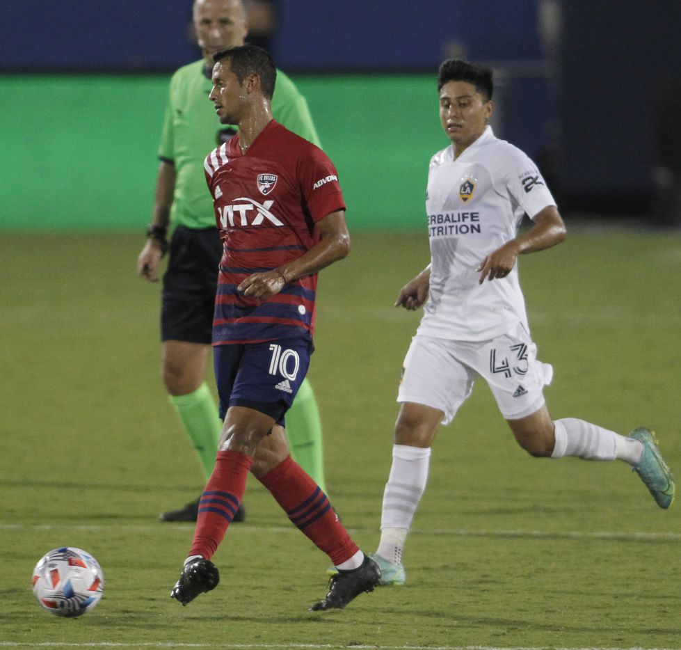 FC Dallas midfielder Andres Ricuarte (10) passes to a teammate as LA Galaxy midfielder Adam Saldana (43) defends during first half action. The two teams played their MLS match at Toyota Stadium in Frisco on July 24, 2021. (Steve Hamm/ Special Contributor)