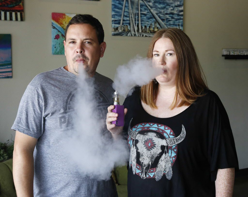 Chris and Erin Freeman co-owners of Good Vapes in Dallas demonstrate how a Vaping device is used in their store on Tuesday, August 18, 2015.