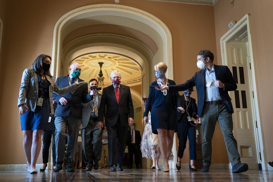 Senate Majority Leader Mitch McConnell (R-KY) is swarmed by reporters as he leaves the Senate floor and walks to his office at the U.S. Capitol on July 30, 2020 in Washington, DC. Republicans and Democrats in the Senate remain in a stalemate as the the $600-per-week federal unemployment benefit in place due to the coronavirus pandemic is set to expire on Friday.