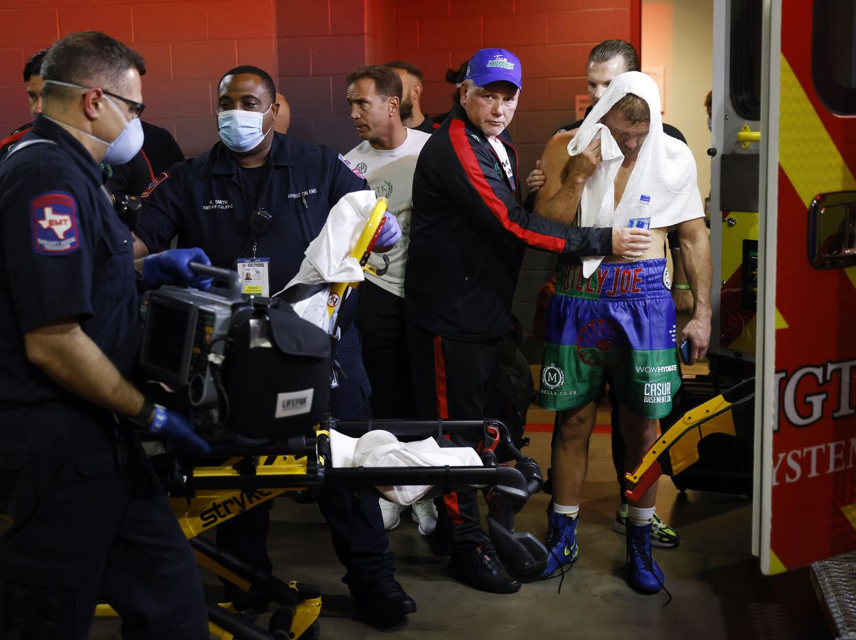 Boxer Billy Joe Saunders waits to get in an ambulance after sustaining an eye injury during his unified super middleweight title fight against Canelo Alvarez at AT&T Stadium in Arlington, Saturday, May 8, 2021. Saunders was reportedly taken to the hospital. (Tom Fox/The Dallas Morning News)