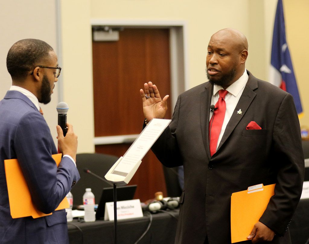 New trustee Maxie Johnson is sworn in to the Dallas ISD board by fellow trustee Justin Henry. Johnson, the pastor of New Morning Star Missionary Baptist Church, takes over the District 5 seat long held by Lew Blackburn.