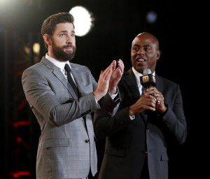 John Krasinski, who plays Jack Silva, applauds the crowd during an interview with Kevin Frazier, host of Entertainment Tonight, on the red carpet at the world premiere of 13 Hours: The Secret Soldiers of Benghazi at AT&T Stadium in Arlington, Texas on Jan. 12, 2016. (Rose Baca/The Dallas Morning News)