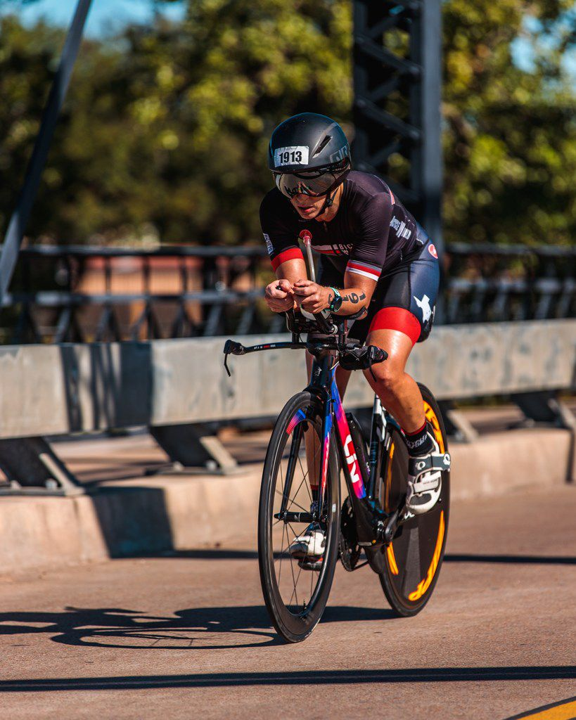 Brandi Grissom Swicegood cycles toward the finish of the Ironman 70.3 Waco bike leg on Oct. 28, 2018.