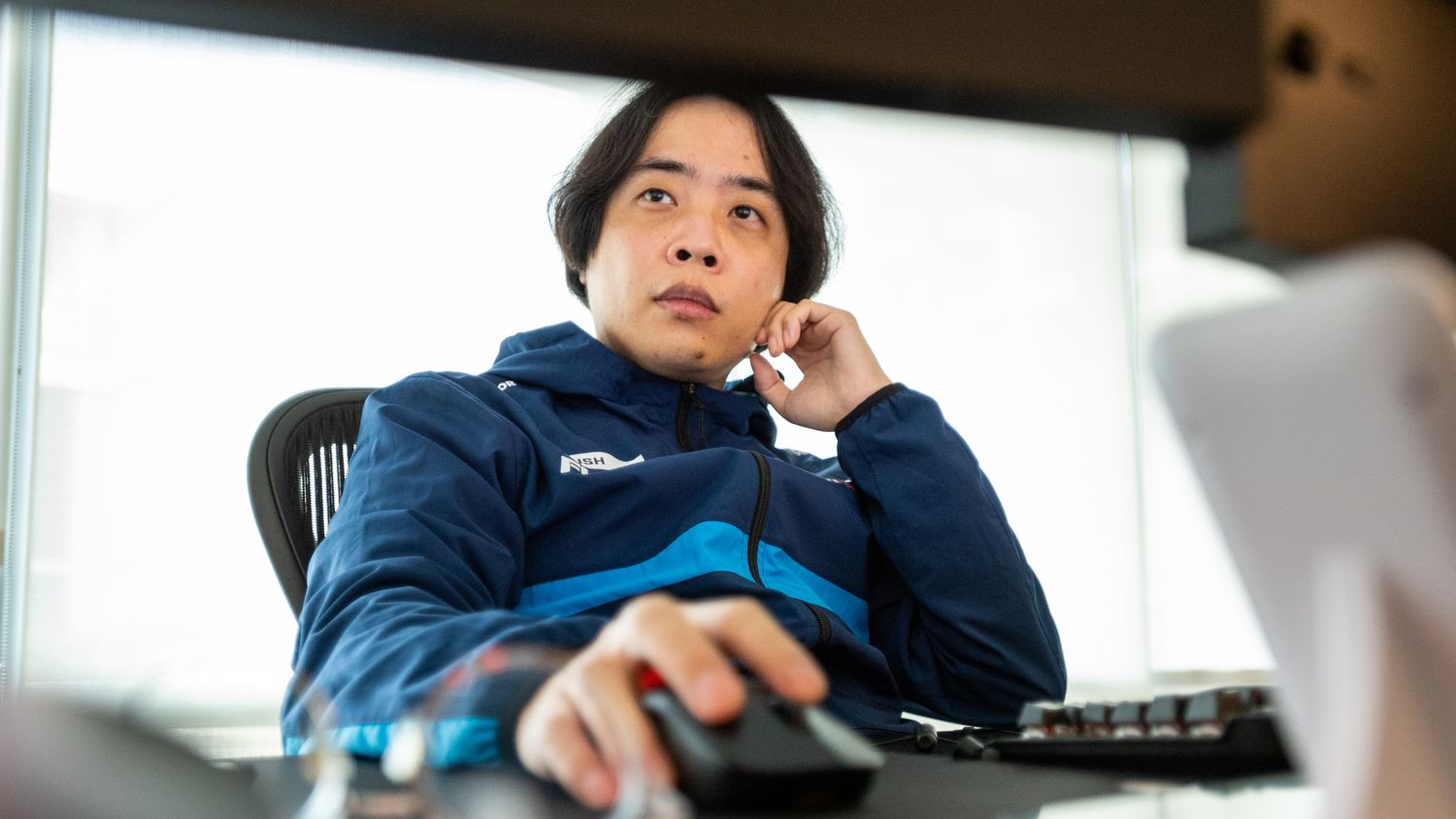 """Dallas Fuel head coach Hee-Won """"Rush"""" Yun studies game play on computer monitors during practice time at the Dallas Fuel headquarters in Dallas, on Monday, Sept. 13, 2021."""