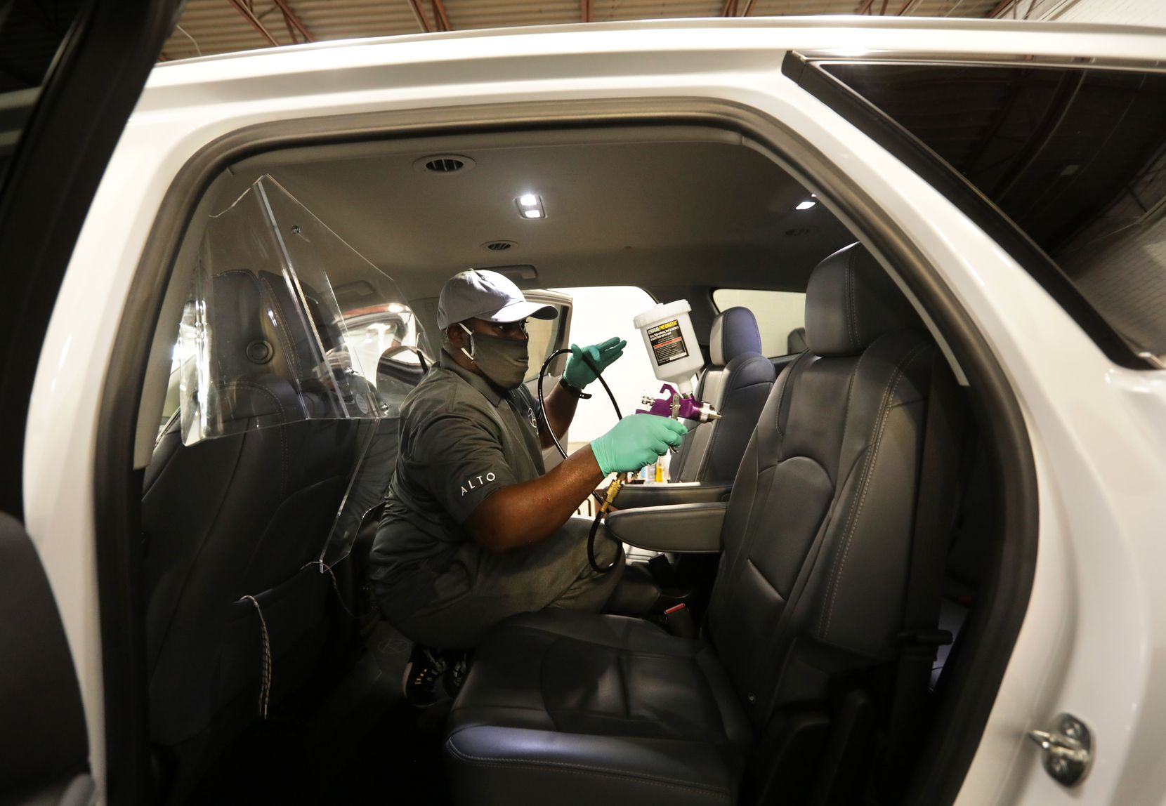 Gregory Brown sprays PermaSafe disinfectant in a vehicle at Alto headquarters in Dallas. PermaSafe is a hospital-grade sanitizing mist that kills 99.9% of bacteria and viruses, including emerging pathogens like COVID-19.