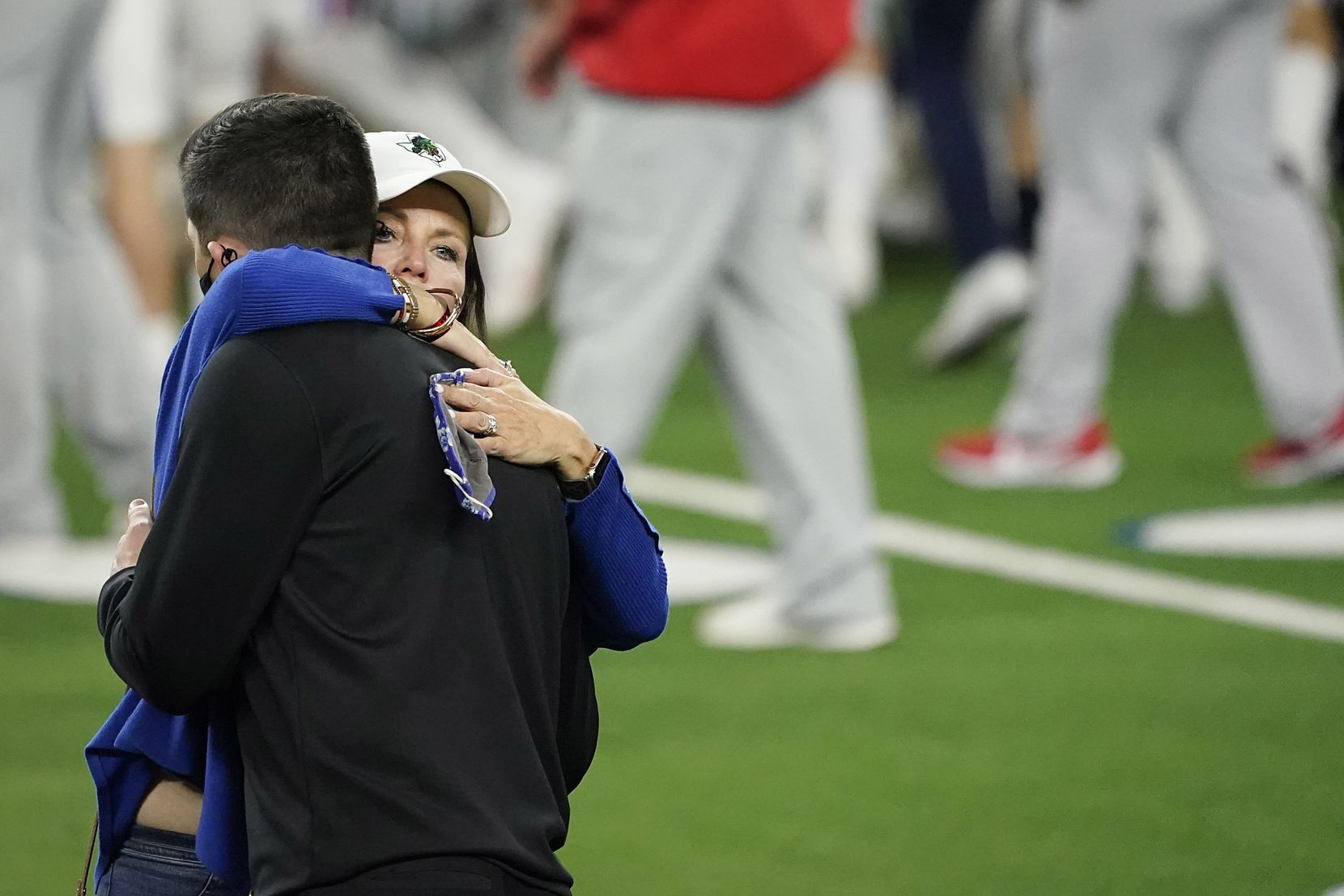 Southlake Carroll head coach Riley Dodge gets a hug from his mother Elizabeth Dodge after a 52-34 loss to Austin Westlake, coached by his father Todd Dodge, in the Class 6A Division I state football championship game at AT&T Stadium on Saturday, Jan. 16, 2021, in Arlington, Texas.