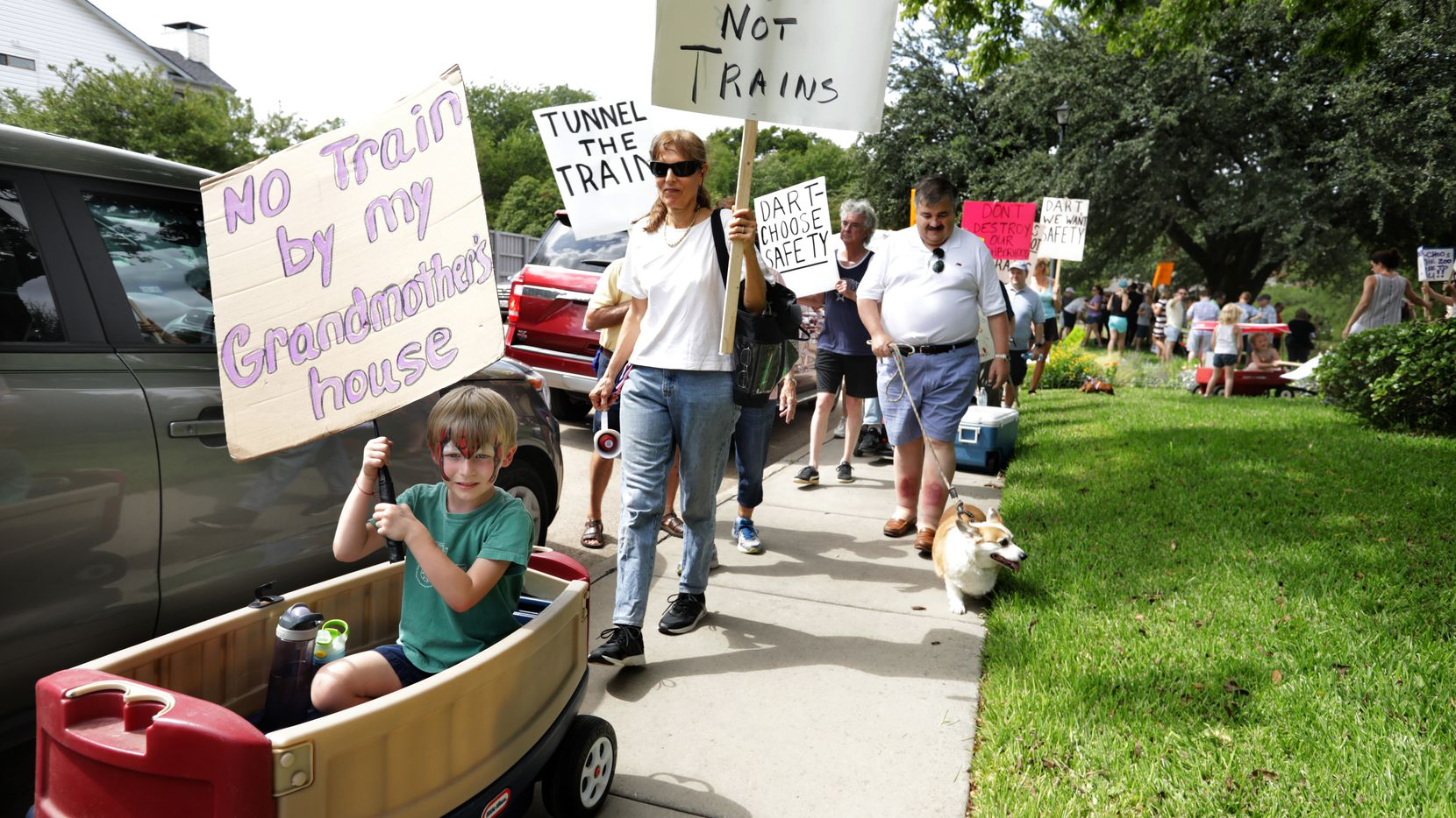 Area residents protest DART's proposed Cotton Belt Line plans as they walk along the Preston Ridge Trail in Dallas on Sep. 22, 2019.