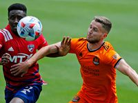 FC Dallas defender Eddie Munjoma (2) and Houston Dynamo defender Adam Lundqvist (3) race to the soccer ball during the first half as FC Dallas hosted the Houston Dynamo at Toyota Stadium in Frisco on May 8, 2021.