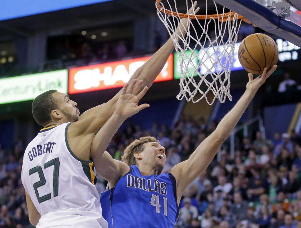 Dallas Mavericks forward Dirk Nowitzki (41) lays the ball up as Utah Jazz center Rudy Gobert (27) defends during the second quarter of an NBA basketball game Wednesday, Nov. 2, 2016, in Salt Lake City. (AP Photo/Rick Bowmer)