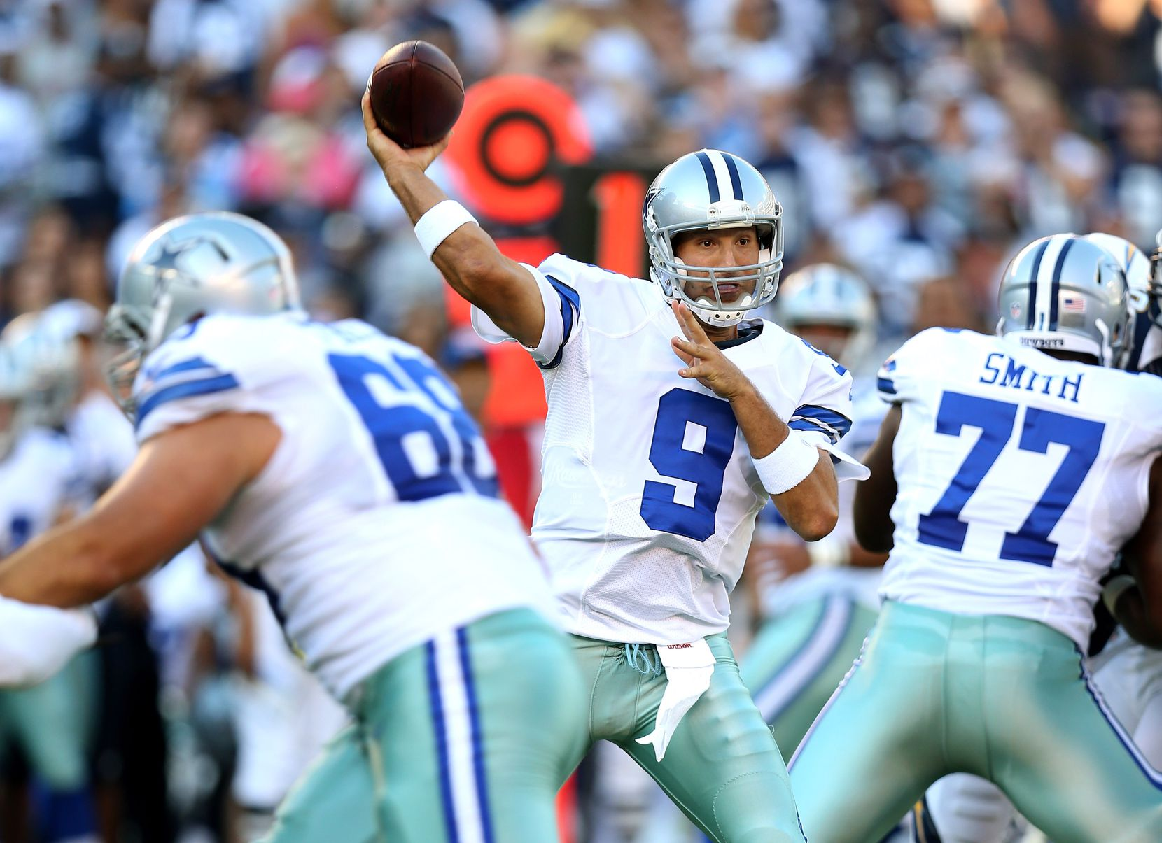 SAN DIEGO, CA - AUGUST 18: Quarterback Tony Romo #9 of the Dallas Cowboys throws a pass against the San Diego Chargers at Qualcomm Stadium on August 18, 2012 in San Diego, California.