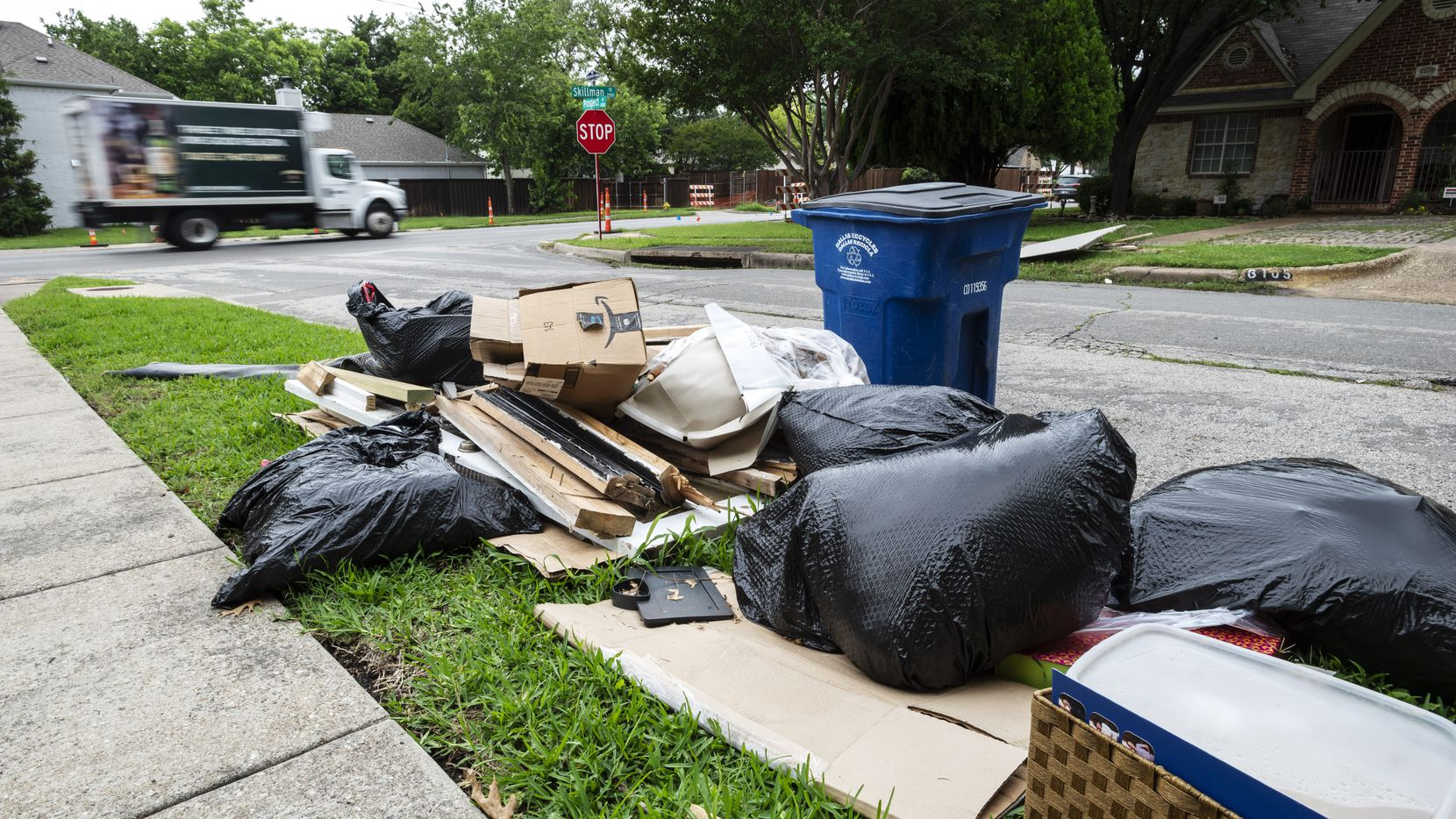 Bulk trash awaits delayed pickup near the intersection of Prospect Avenue and Skillman Street in Dallas in June 2021. Basic city services are suffering in Dallas.