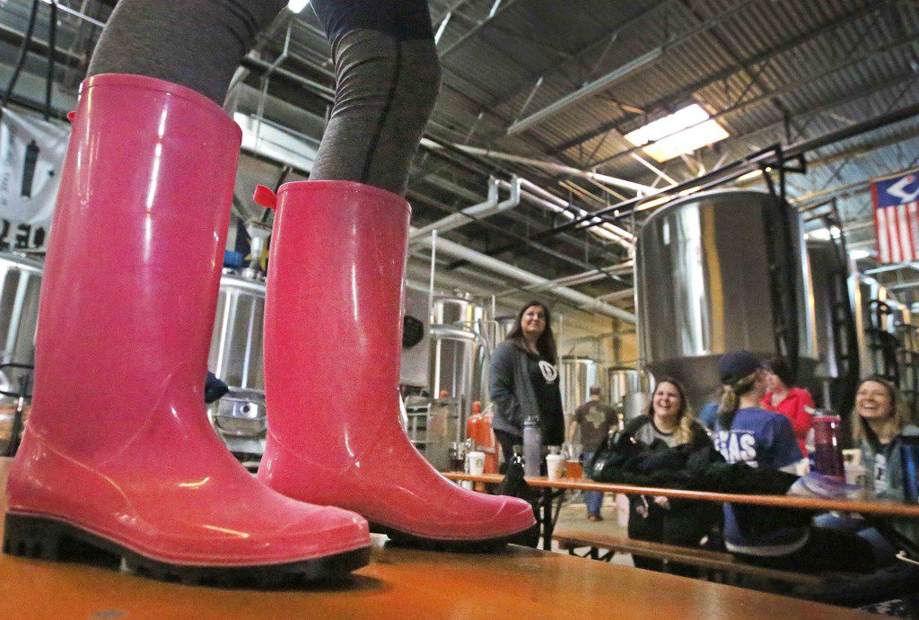 Members of the Northern Texas chapter of Pink Boots Society brews a batch of beer for International Women's Day at the Oak Highlands Brewery in Dallas. Founded in 2017, the group has 25 active members.