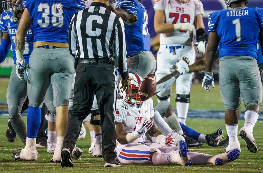 SMU running back Ke'Mon Freeman (2) tosses the ball to the referee after being brought down by the Memphis defense during the second half of an NCAA football game at Liberty Bowl Memorial Stadium on Saturday, Nov. 2, 2019, in Memphis, Tenn. (Smiley N. Pool/The Dallas Morning News)