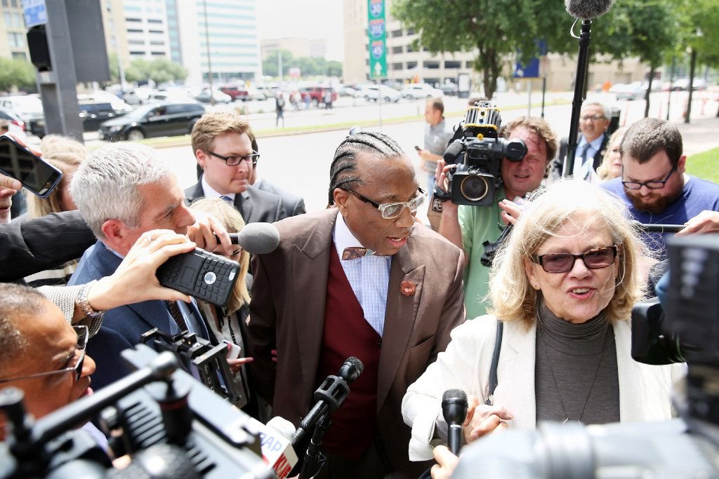 Dallas County commissioner John Wiley Price walks out of the the Earle Cabell Federal Building while holding hands with his lawyer Shirley Baccus-Lobel after being found not guilty of seven counts during his federal corruption trail in Dallas, Friday, April 28, 2017. On the eighth day of deliberations, the jury exonerated Price on seven charges against him and deadlocked on four tax-related counts. The judge declared a mistrial on the deadlocked charges. (Andy Jacobsohn/The Dallas Morning News)