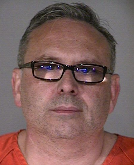 Dr. Allen Pearson was booked into the Plano jail in August after his indictment.