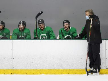 Stars head coach Rick Bowness watches his team work out alongside defensemen (from left) Dawson Barteaux (65), Miro Heiskanen (4), Julius Honka (6) and Ryan Shea (46) during training camp at Comerica Center on Wednesday, Jan. 6, 2021, in Frisco.