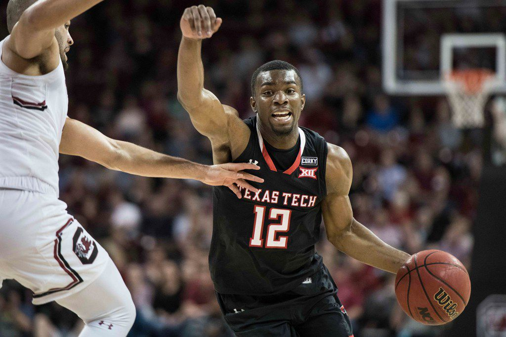 Texas Tech guard Keenan Evans (12) dribbles the ball against South Carolina guard Frank Booker, left, during the second half of an NCAA college basketball game Saturday, Jan. 27, 2018, in Columbia, S.C. Texas Tech defeated South Carolina 70-63. (AP Photo/Sean Rayford)