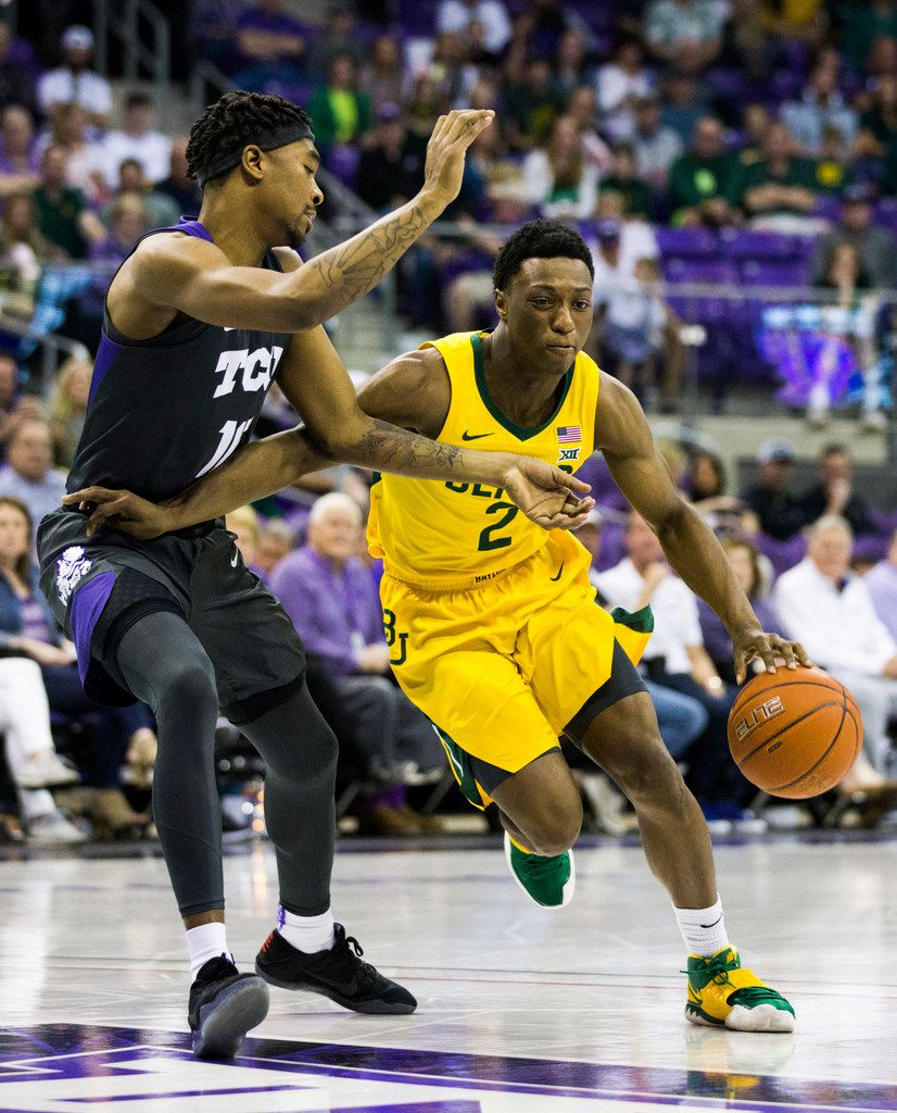 Baylor Bears guard Devonte Bandoo (2) gets around TCU Horned Frogs forward Diante Smith (10) during the first half of an NCAA mens basketball game between Baylor and TCU on Saturday, February 29, 2020 at Ed & Rae Schollmaier Arena on the TCU campus in Fort Worth. (Ashley Landis/The Dallas Morning News)