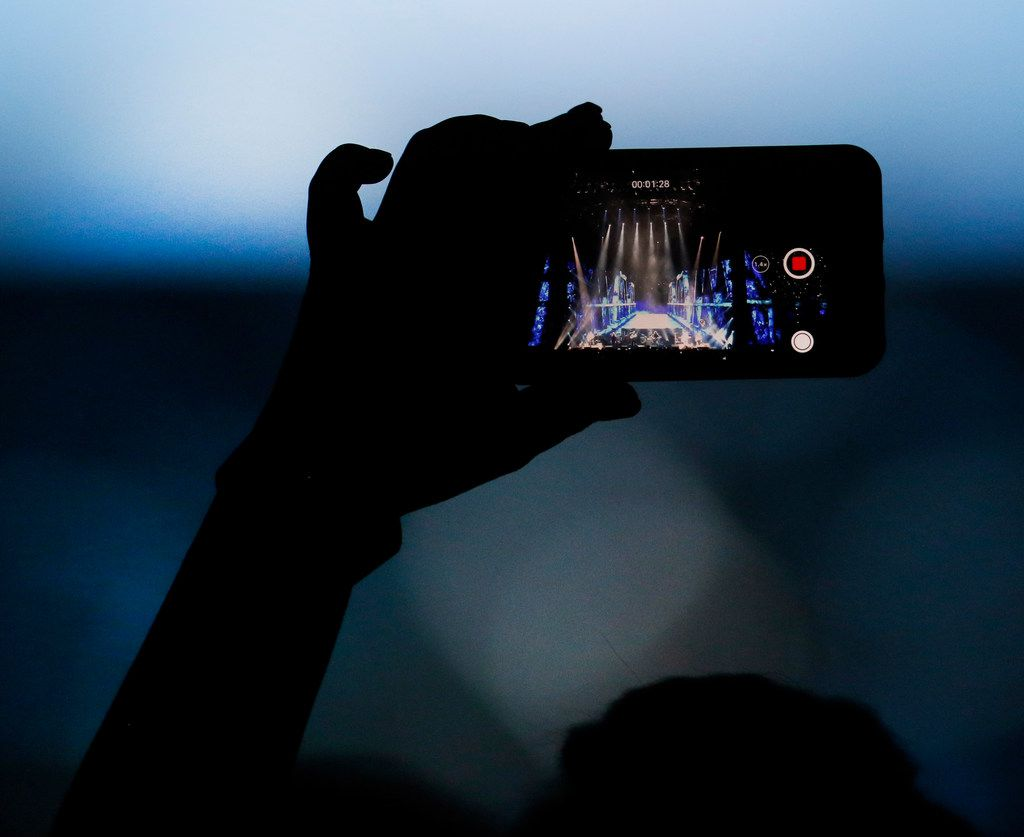 A fan records one of the opening songs as performed by the iconic band the Eagles. Chris Stapleton, who opened the concert and the Eagles performed before a  capacity crowd of their fans at AT&T Stadium in Arlington on June 23, 2018. (Steve Hamm/ Special Contributor)