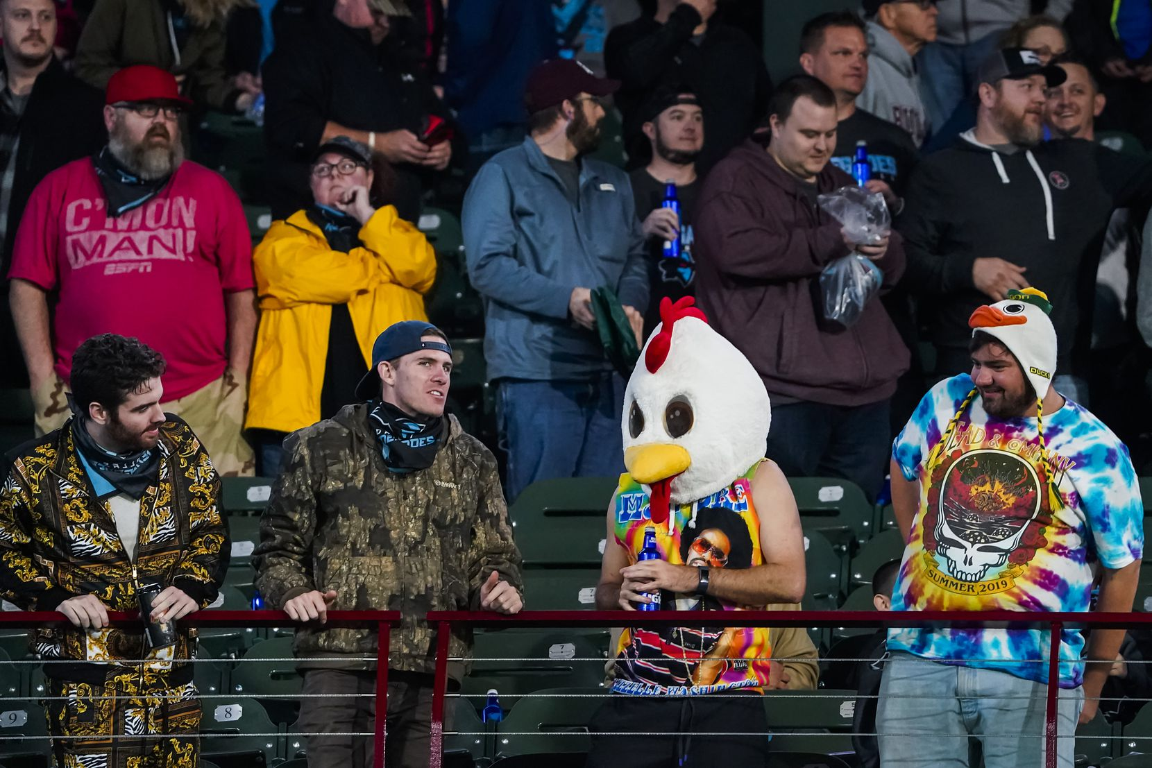 Dallas Renegades fans react after the St. Louis Battlehawks intercepted a pass in the final minute of an XFL football game at Globe Life Park on Sunday, Feb. 9, 2020, in Arlington.