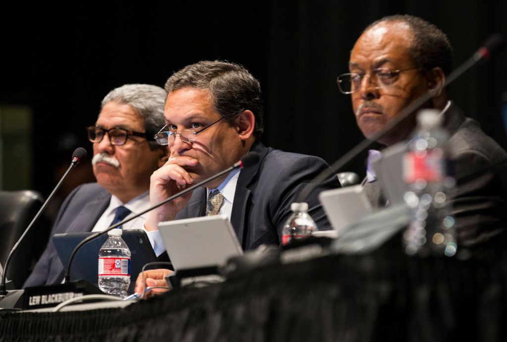 DISD trustees, from left, Superintendent Michael Hinojosa, Edwin Flores and Lew Blackburn listen to public comment before voting on several last-minute variations of the district's school closing plan on Thursday, January 25, 2018 at Lincoln High School and Communications/Humanities Magnet in Dallas.