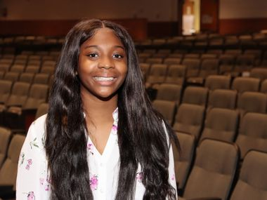 Ladasia Rhone graduated from Arlington High School on Thursday with perfect attendance since kindergarten.