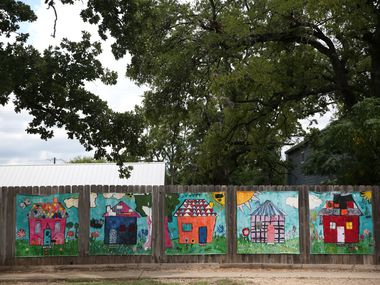 Texas does a poor job of policing shoddy foster-care providers, which endangers some of the state's most vulnerable children, a federal judge said Thursday. Shown in a 2017 file photo are paintings of houses by foster children at Austin's Helping Hand Home, the oldest continuously operating residential child care agency in Travis County.