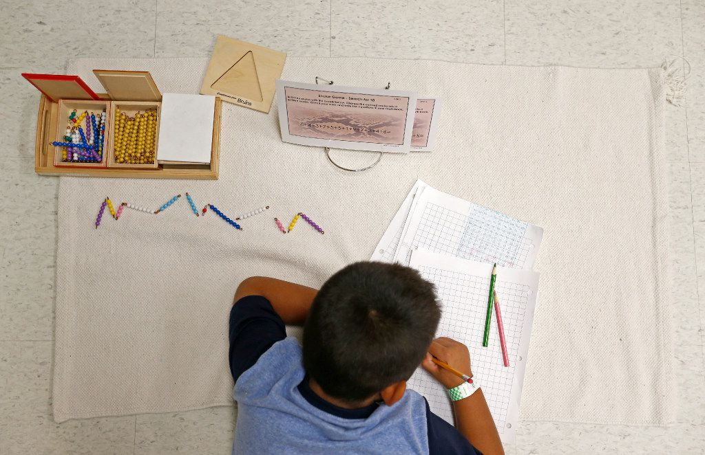 First-grander Angel Gutierrez works on a math problem during a Lower Elementary Dual Language class at Mata Montessori in Dallas. (Jae S. Lee/The Dallas Morning News)
