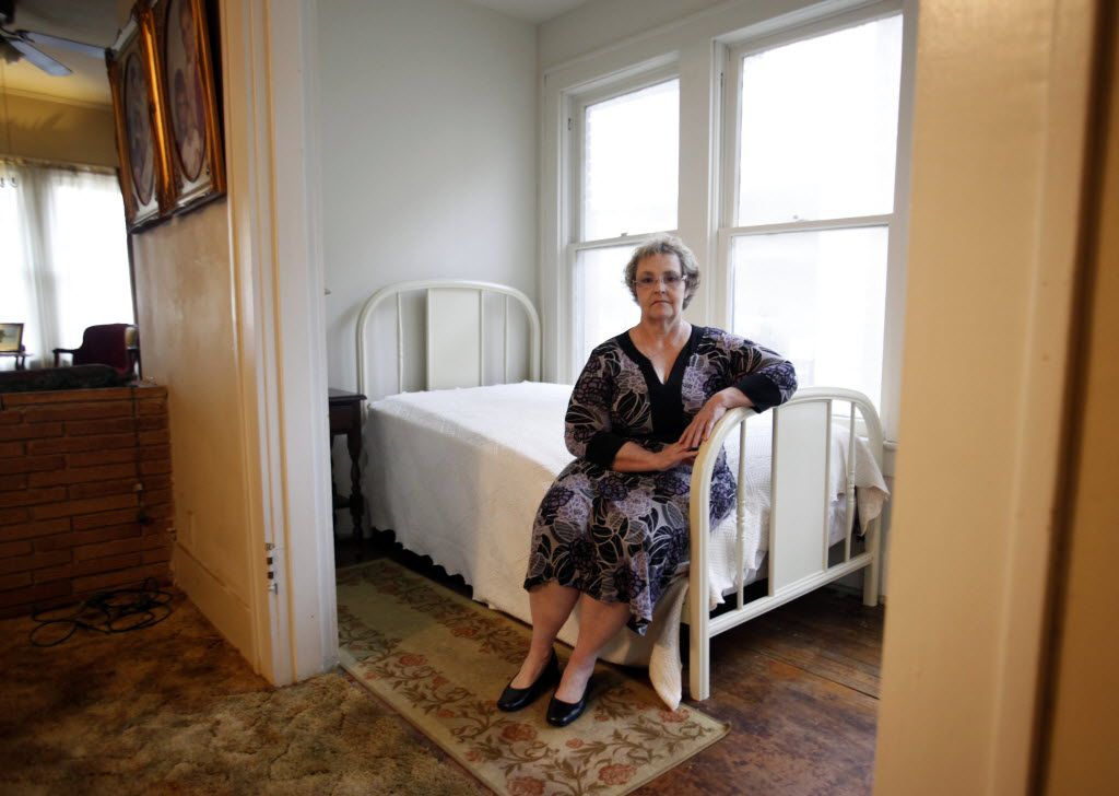 Patricia Puckett Hall poses for a photo inside the small room in her house on North Beckley Avenue in Dallas, where Lee Harvey Oswald was living on Nov. 22, 1963, the day President John F. Kennedy was assassinated.