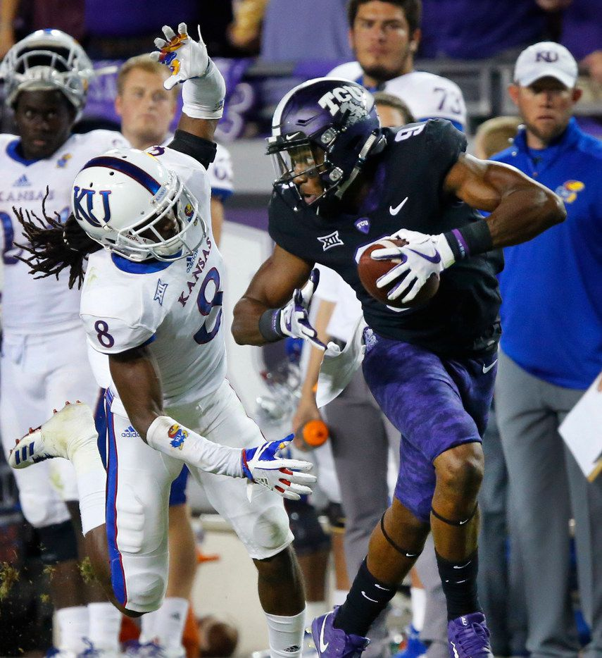 TCU Horned Frogs wide receiver John Diarse (9) breaks away from Kansas Jayhawks cornerback Shakial Taylor (8) as he raced down the sideline for a long second quarter touchdown at Amon G. Carter Stadium in Fort Worth, Texas, Saturday, October 21, 2017. (Tom Fox/The Dallas Morning News)
